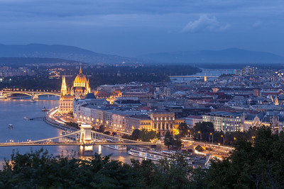A view overlooking Budapest, Hungary, and the winding Danube River at dusk.