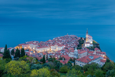 Sea and sky blend into one in this view from atop the old city walls above Piran, Slovenia, at dusk.