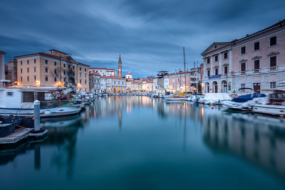 The harbor in the town of Piran on Slovenia's Istrian coast at dusk.