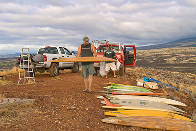 Tim Orr carefully handling one of his many vintage Bonzer surfboards. Big Island Hawaii, July 2011.