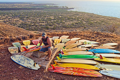 Tim Orr and his quiver of modern and vintage Bonzer surfboards overlooking Makalawena. Big Island Hawaii, July 2011