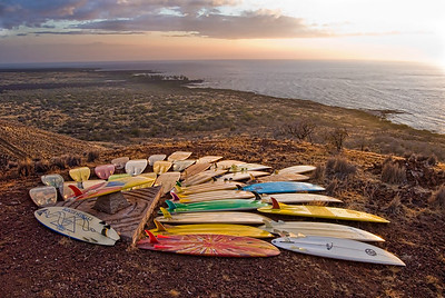 Modern and vintage Bonzer surfboards as swell lines wrap into Makalawena. Big Island Hawaii, July 2011.