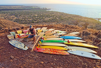 Tim Orr and his quiver of modern and vintage Bonzer surfboards overlooking Makalawena. Big Island Hawaii, July 2011.