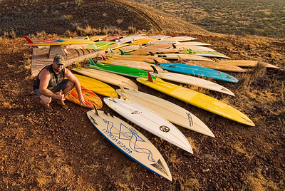 Tim Orr and his quiver of nearly forty vintage Bonzer surfboards. Big Island Hawaii, July 2011.