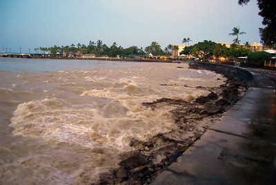 This is the view as the water rushed back in as the wave crested. A second after taking this photo, the wave crested the seawall and I was running back across the street for high ground...