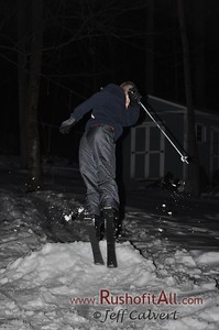 Lucas on his home-made ski jump at our house.