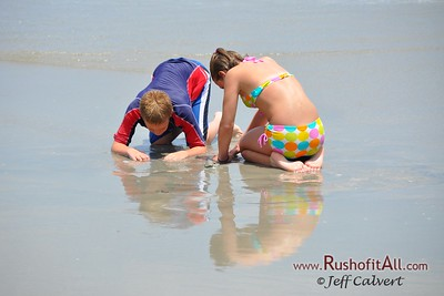 Surfside Beach, South Carolina - looking for clams.