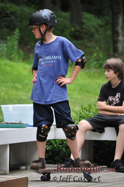 Lucas, Jacob, Josh, and Jeremy skateboard session on our back deck during the Baehr's visit to State College, July 2009.