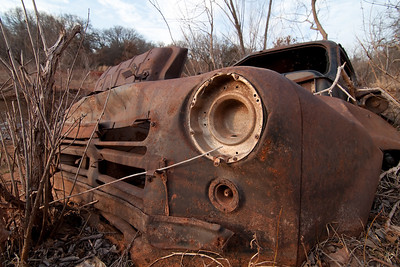 An old truck at Lake Thunderbird in Norman Oklahoma.  It's about half buried in mud, who know's how long it's been there