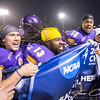 "Minnesota State players celebrate with a banner that reads ""Kansas City, here we come"" after winning the NCAA Division II playoff semi-final at Bankslee Stadium in Mankato Saturday. Photo by Trevor Cokley"