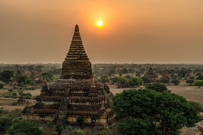 The sun rises above the thousands of pagodas adorning the floodplains of Bagan.