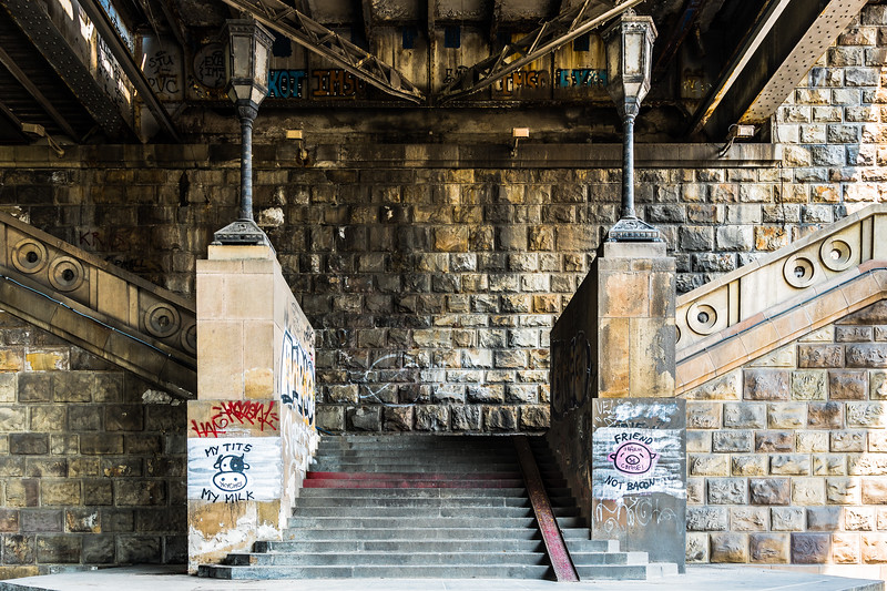 Vegan graffiti lay claim to twin pillars beneath a Belgrade bridge.
