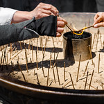 Pilgrims offer incense at Nara's Tōdai-ji temple.
