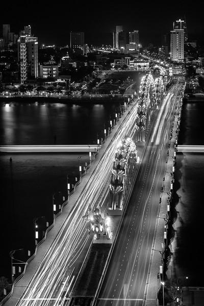 Traffic over Da Nang's Dragon Bridge lights the night.