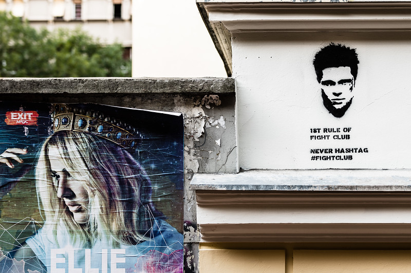 Street art and festival advertising compete for space on the walls of central Belgrade.