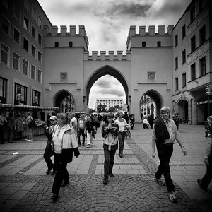 Munich, people passing through the Karlstor city gate.