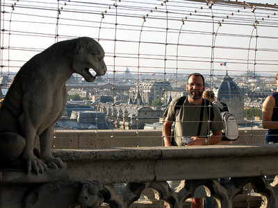 Another of the famous gargoyles at Notre Dame, with Joe in the background.