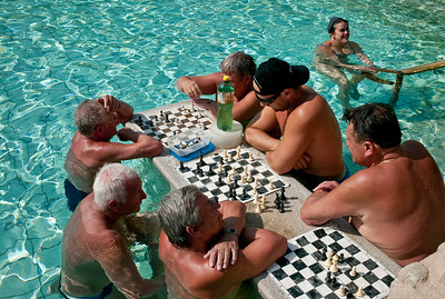 March , 2012, Budapest, Hungary -  Locals play chess in the water at  one of three outdoor pools in Szechenyi Bath, where locals and tourists spend as long as 10 hrs a day in the water.   Budapest is known as the SPA Capital of the world.  Nearly 120 hot springs feed the city's historic thermal baths (Furdo) and approximately 70 million litres of water used every day.
