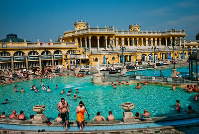 March , 2012, Budapest, Hungary - View of one of three outdoor pools in Szechenyi Bath, where locals and tourists spend as long as 10 hrs a day   in the water.   Budapest is known as the SPA Capital of the world.  Nearly 120 hot springs feed the city's historic thermal baths (Furdo) and approximately 70 million litres of water used every day.