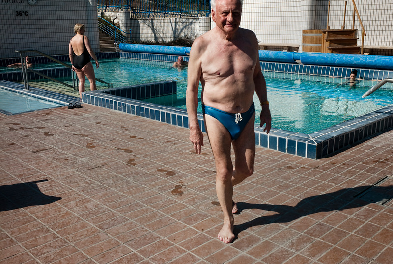 March , 2012, Budapest, Hungary -  German tourist enjoys the spa and baths at  the Gellert hotel and SPA.    Budapest is known as the SPA Capital of the world.  Nearly 120 hot springs feed the city's historic thermal baths (Furdo) and approximately 70 million litres of water used every day.