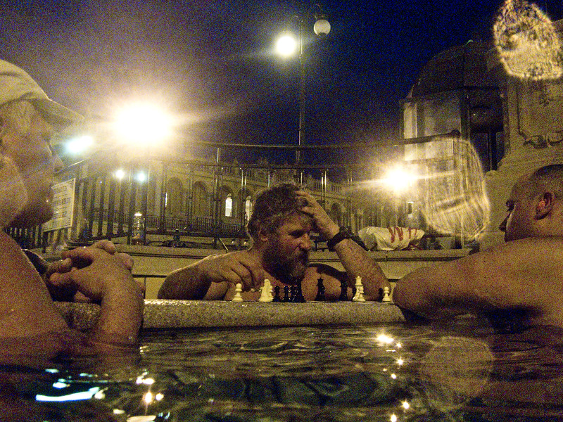 March , 2012, Budapest, Hungary -  Regular local visitors enjoy evening chess at Szechenyi Bath and Spa.   Budapest is known as the SPA Capital of the world.  Nearly 120 hot springs feed the city's historic thermal baths (Furdo) and approximately 70 million litres of water used every day.