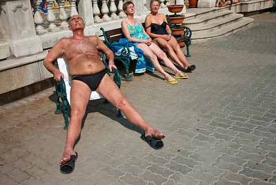 March , 2012, Budapest, Hungary -  Regular local visitors take sun bath in between their swims at Szechenyi Bath and Spa.   Budapest is known as the SPA Capital of the world.  Nearly 120 hot springs feed the city's historic thermal baths (Furdo) and approximately 70 million litres of water used every day.