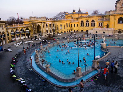 March , 2012, Budapest, Hungary - View of one of three outdoor pools (which also has whirlpool) in Szechenyi Bath.   Budapest is known as the SPA Capital of the world.  Nearly 120 hot springs feed the city's historic thermal baths (Furdo) and approximately 70 million litres of water used every day.