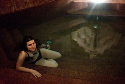 March , 2012, Budapest, Hungary -  Young woman from Germany enjoys her night batch at Rudas bath.   Budapest is known as the SPA Capital of the world.  Nearly 120 hot springs feed the city's historic thermal baths (Furdo) and approximately 70 million litres of water used every day.