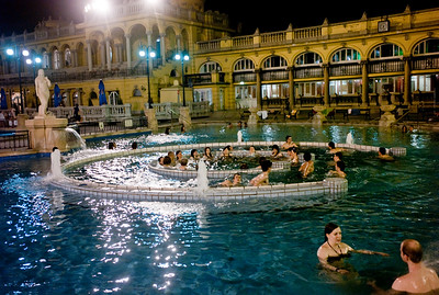 March , 2012, Budapest, Hungary -  Visitors enjoy a night bath in a whrilpool at Szechenyi Bath and Spa.   Budapest is known as the SPA Capital of the world.  Nearly 120 hot springs feed the city's historic thermal baths (Furdo) and approximately 70 million litres of water used every day.