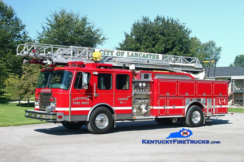 <center> Lancaster  Ladder 1 <br> 1997 E-One Cyclone II 1500/500/75'  <br> Kent Parrish photo </center>