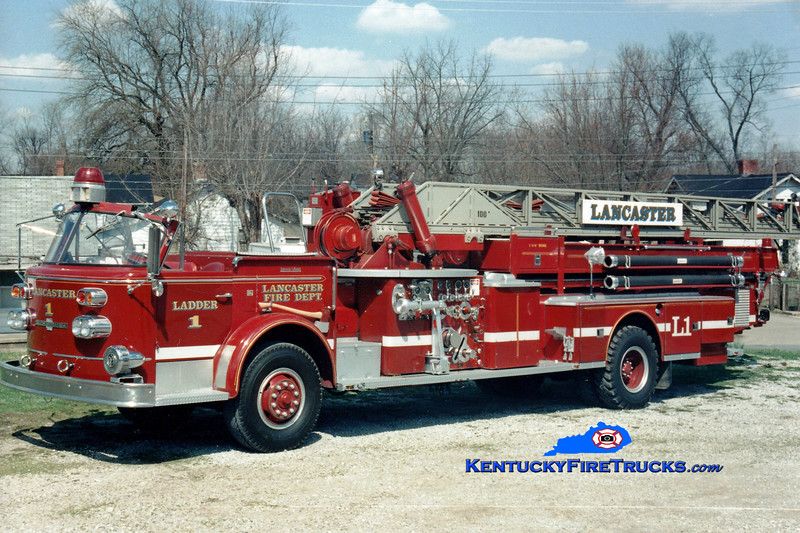 <center> RETIRED <br> Lancaster  Ladder 1 <br> x-Fostoria, OH <br> 1965 American LaFrance 1000/200/100'  <br> Greg Stapleton photo </center>