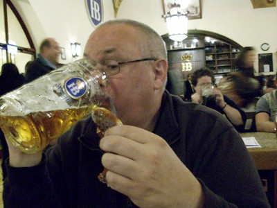 A big pretzel in one hand, an even bigger beer in the other. Ed is one happy vacationer. Hofbrauhaus in Munich.