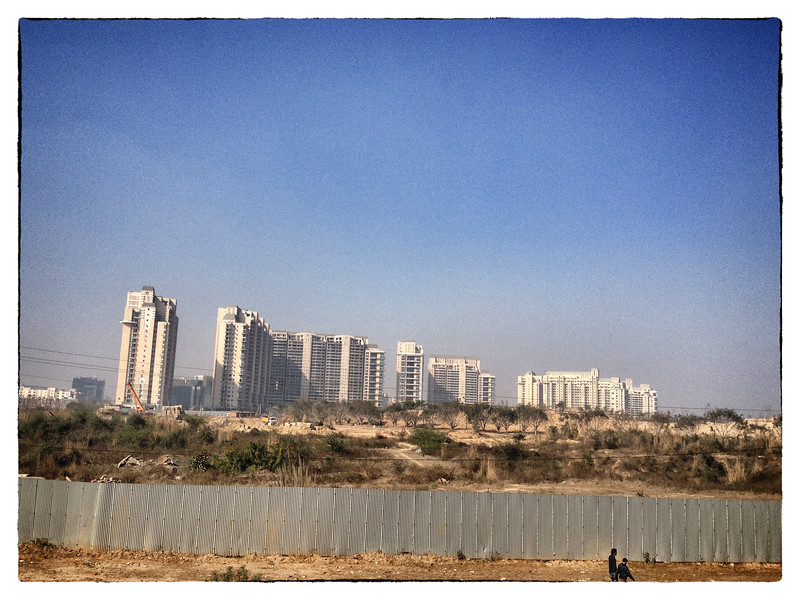 Delhi, India, Feb 2013 -    View of the golf course under construction in Gurgaon, an up and coming residential and business area in greater Delhi where water is scarce due to lack of infrastructure.  The water for the lawn and residential usage are purchased from private water tanker operators.   Images for the Global Post's special report -   The Great Divide:  Global income inequality and its cost    Photograph:  Sami SIVA