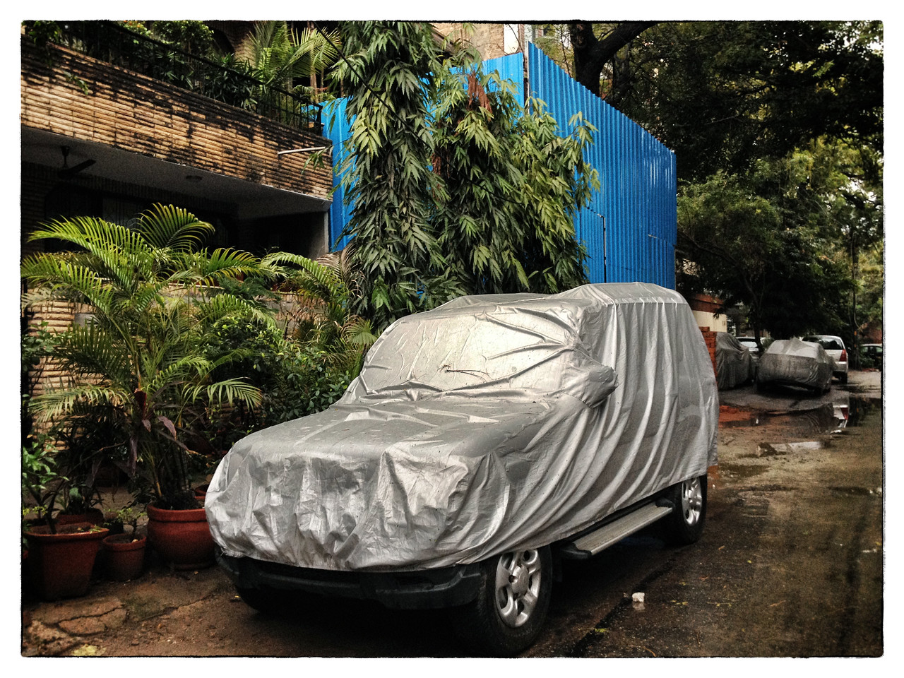 Delhi, India, Feb 2013 -   An SUV covered with plastic  to protect from the rain.     Images for the Global Post's special report -   The Great Divide:  Global income inequality and its cost    Photograph:  Sami SIVA