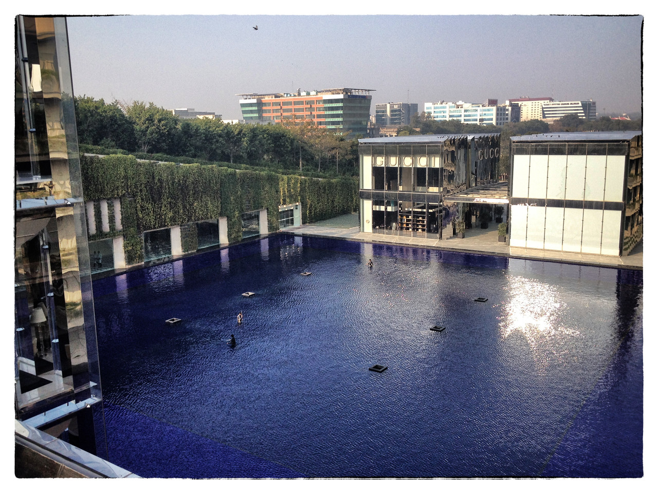 Delhi, India, Feb 2013 -   View of the large pond,  which is also lit at nights, seen at Oberoi in Gurgaon.An area where large commercial and residential projects are coming up but lacks infrastructure for clean water.     Images for the Global Post's special report -   The Great Divide:  Global income inequality and its cost    Photograph:  Sami SIVA