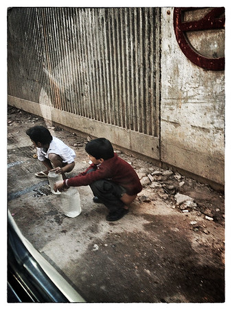 Delhi, India, Feb 2013 -   Children seen defecating under a metro rail bridge in Delhi.  Approximately 60%  of Indians don't have closed toilet which consequently leads to open defecation.    Images for the Global Post's special report -   The Great Divide:  Global income inequality and its cost    Photograph:  Sami SIVA