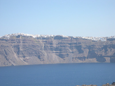 Firastephanie on the left and Thira on the right are visible from the volcanic island of Nea Kameni.