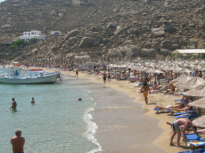 Mykonos. Super Paradise Beach. The small boats carry people back and forth from the cove throughout the day.