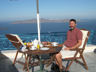 Joe enjoying breakfast out by the pool. The views across the caldera and the ocean couldn't have been any more stunning. That's the town of Thirasia on the opposite side of the caldera.