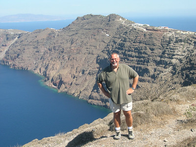 Ed on the path from Thira to Oia. Stunning views of the volcano. You can see the continuation of the trail in the background.