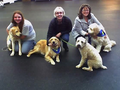 Some Canine Good Citizen (CGC) graduates...and their proud humans!