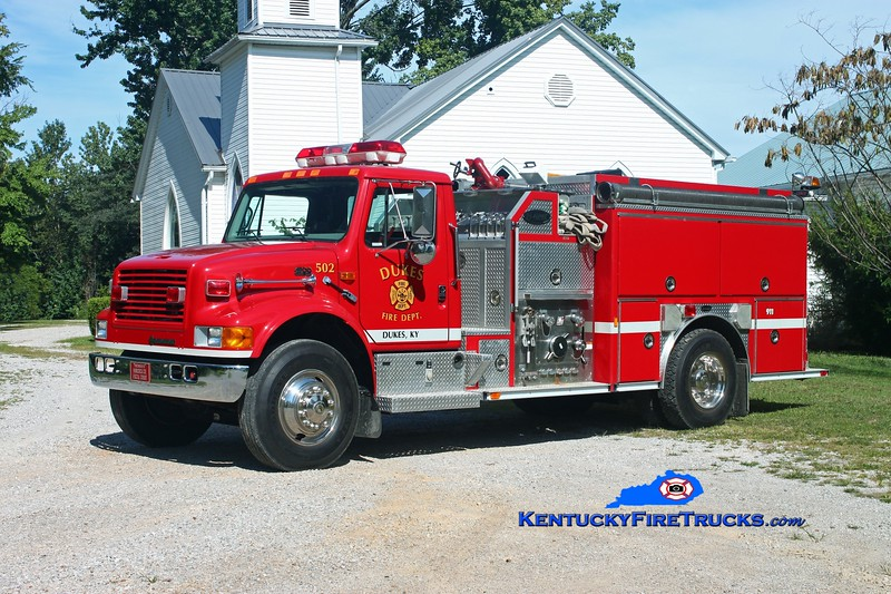 <center> Dukes  Engine 502 <br> 1998 International 4900/E-One 1250/1000 <br> Kent Parrish photo </center>