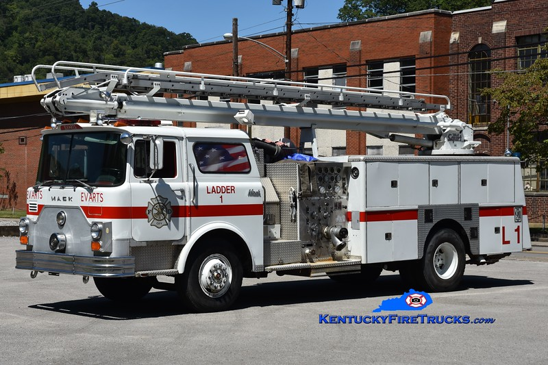 Evarts  Ladder 1<br /> x-Arvada, CO and Loyall, KY<br /> 1980 Mack CF 1250/500/50' TeleSqurt<br /> Greg Stapleton photo