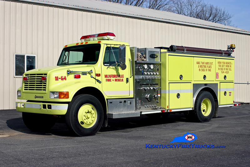<center> RETIRED <br> Munfordville  Engine 64 <br> 1999 International 4900/E-One 1250/1000 <br> Kent Parrish photo <br> </center>