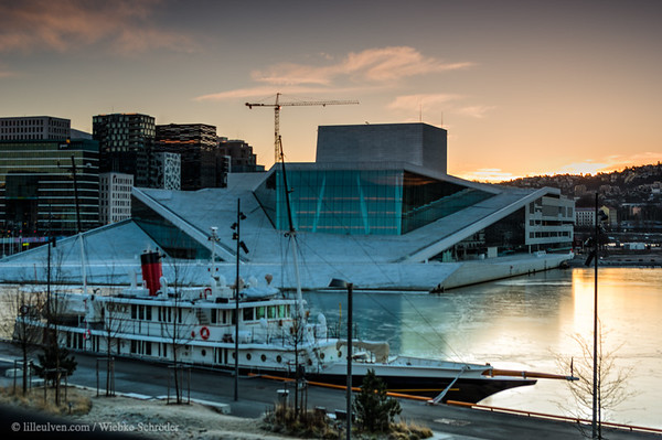 Photographing the sunrise over the Opera building in Oslo. In the foreground the Grace, a Dutch research vessel for oceanographic research.