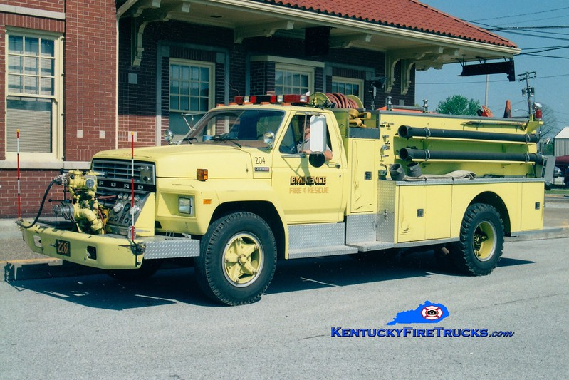 <center> RETIRED <br> Eminence Tanker 2261 <br> 1980 Ford F/American 750/1500 <br> Greg Stapleton photo </center>