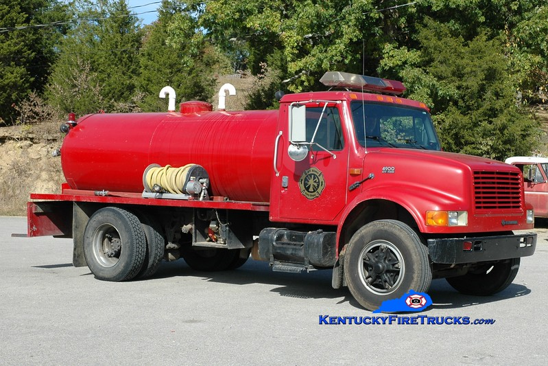 <center> RETIRED <br> Kentucky River  Tanker 5565 <br> 1996 International 4900/Local 250/1500 <br> Greg Stapleton photo </center>