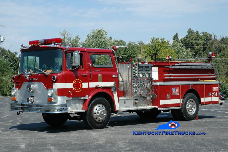 <center> RETIRED <br> Grapevine  Engine 204<br> x-St. Matthews, KY  <br> 1976 Mack CF 1500/500 <br> Greg Stapleton photo </center>