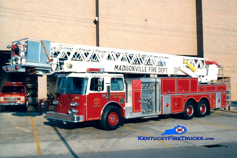 <center> RETIRED <br> Madisonville  Aerial 1 <br> 1987 Duplex D-350/Grumman 1500/250/102'  <br> Greg Stapleton photo </center>
