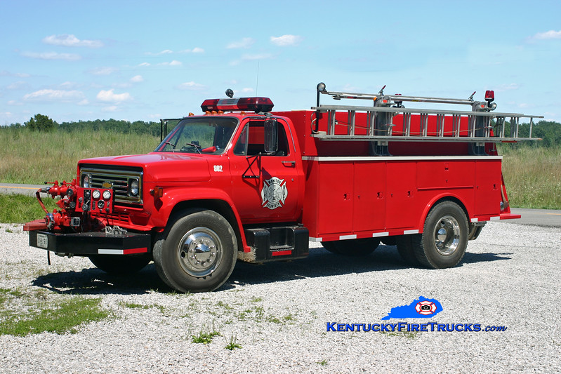 <center> RETIRED <br> Manitou  Engine 902 <br> 1981 Chevy/Local 750/1000 <br> Kent Parrish photo </center>